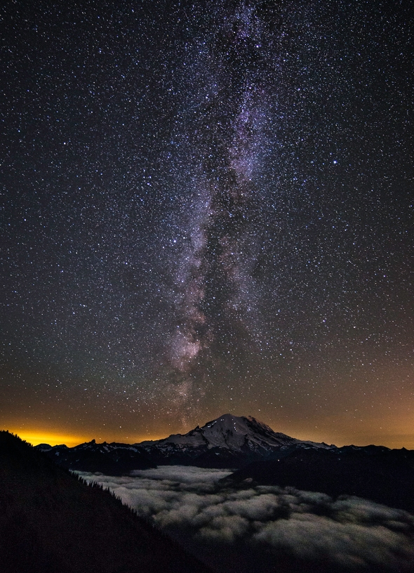 Mount Rainier and the Milky Way. The lights on the mountains flanks are headlamps of climbers headed for the summit.